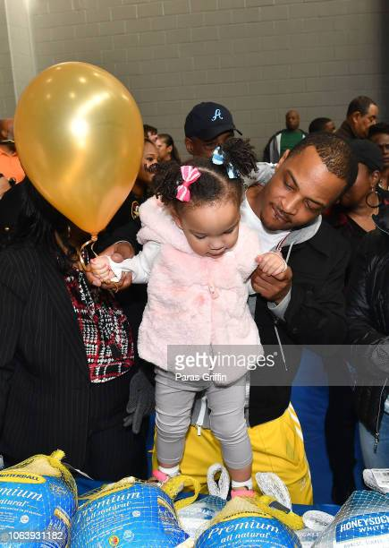 Rapper/actor TI with his daughter Heiress Diana Harris at Tip TI Harris' 13th Annual Thanksgiving Turkey Giveaway at Adamsville Recreation Center on...