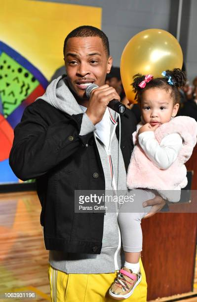 """Rapper/actor T.I. With his daughter Heiress Diana Harris at Tip """"T.I."""" Harris' 13th Annual Thanksgiving Turkey Giveaway at Adamsville Recreation..."""
