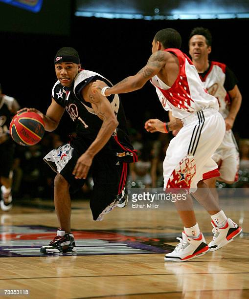 Rapper/east player Nelly drives to the basket against rapper/west player Bow Wow during the McDonald's NBA AllStar Celebrity Game presented by 2K...