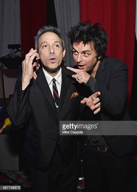 Rapper/musician AdRock and singer/songwriter Billie Joe Armstrong pose for a picture backstage at The 6th Annual Little Kids Rock Benefit presented...