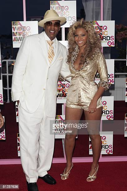 Rapper/producer and nominee JayZ and singer Beyonce Knowles arrive at the 2004 MTV Video Music Awards at the American Airlines Arena August 29 2004...