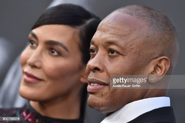 Rapper/producer Dr Dre and wife Nicole Young arrive at the premiere of 'The Defiant Ones' at Paramount Theatre on June 22 2017 in Hollywood California