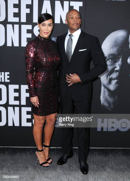 Rapper/producer Dr Dre and wife Nicole Young attend the Premiere of HBO's 'The Defiant Ones' at Paramount Theatre on June 22 2017 in Hollywood...