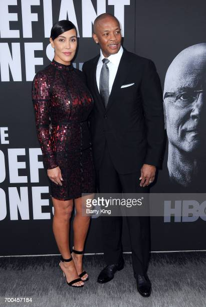 Rapper/producer Dr Dre and wife Nicole Young attends the Premiere of HBO's 'The Defiant Ones' at Paramount Theatre on June 22 2017 in Hollywood...