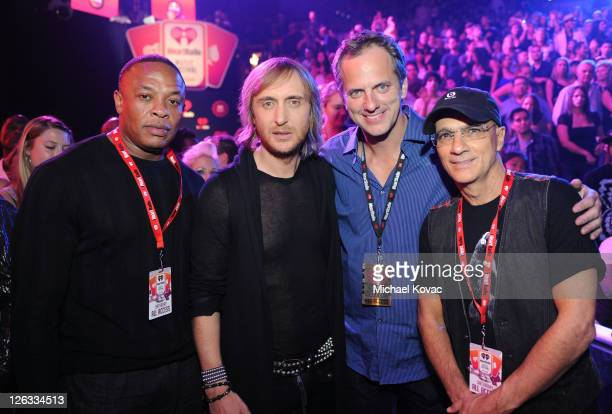 Rapper/producer Dr Dre DJ David Guetta John Coleman and Jimmy Iovine pose in the VIP Lounge at the iHeartRadio Music Festival held at the MGM Grand...