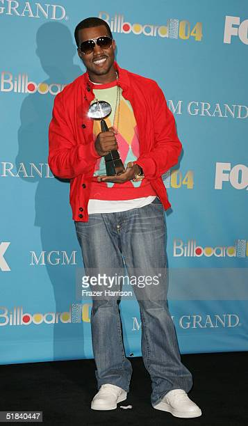 Rapper/producer Kanye West poses backstage with his award at the 2004 Billboard Music Awards at the MGM Grand Garden Arena on December 8 2004 in Las...