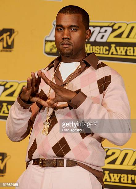 Rapper/producer Kanye West poses in the press room during the MTV Europe Music Awards 2004 at Tor di Valle November 18 2004 in Rome Italy