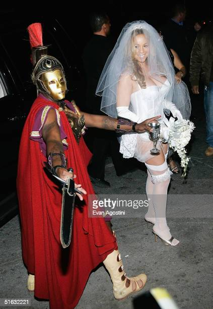 Rapper/producer Sean P Diddy Combs and singer Mariah Carey arrive at her Halloween party at Cain October 31 2004 in New York City