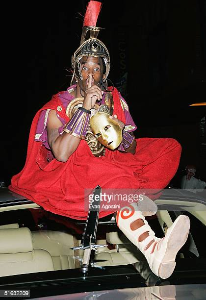 Rapper/producer Sean 'P Diddy' Combs sits on top of his Rolls Royce as he attends singer Mariah Carey's Halloween party at Cain October 31 2004 in...