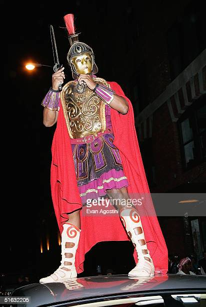 Rapper/producer Sean 'P Diddy' Combs stands on top of his Rolls Royce as he attends singer Mariah Carey's Halloween party at Cain October 31 2004 in...