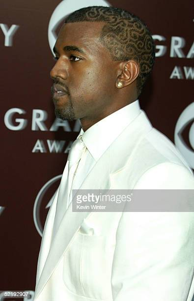 Rapper/producer/Hip Hop star Kanye West arrives to the 47th Annual Grammy Awards at the Staples Center on February 13 2005 in Los Angeles California