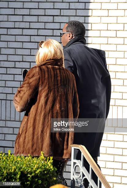 Rapper/record producer Sean P Diddy Combs and his mother Janice Combs walk up the stairs at the funeral service for Heavy D at Grace Baptist Church...
