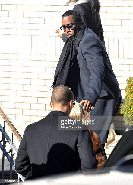 Rapper/record producer Sean P Diddy Combs helps his mother Janice Combs up the stairs at the funeral service for Heavy D at Grace Baptist Church on...