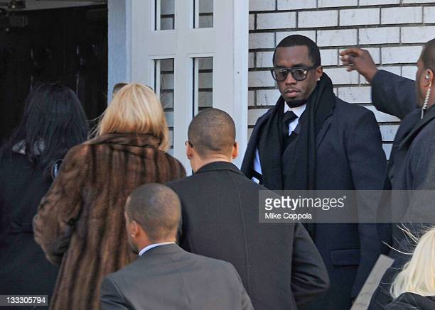 Rapper/record producer Sean P Diddy Combs hold the door open for his mother Janice Combs at the funeral service for Heavy D at Grace Baptist Church...
