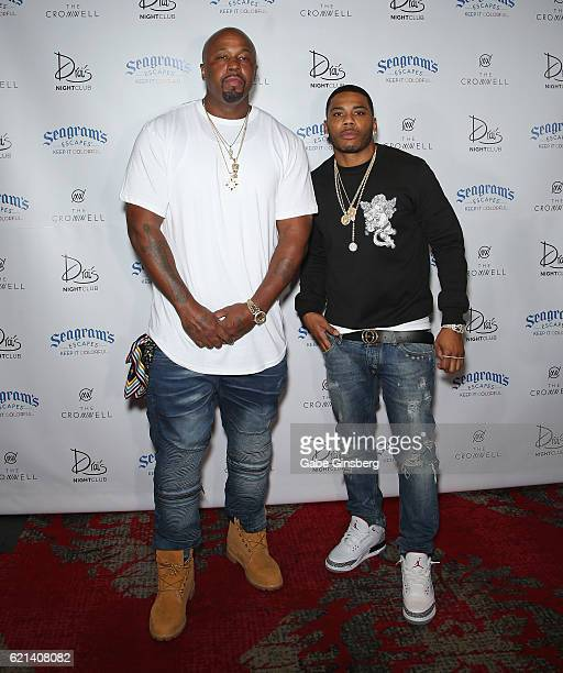 Rappers Ali and Nelly of St. Lunatics arrive at Drai's Beach Club - Nightclub at The Cromwell Las Vegas on November 6, 2016 in Las Vegas, Nevada.