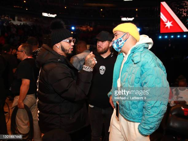 Rappers Anuel AA and Bad Bunny talk during the NBA AllStar Game as part of 2020 NBA AllStar Weekend on February 16 2020 at the United Center in...