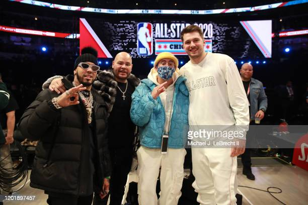 Rappers Anuel AA Fat Joe and Bad Bunny pose for a photo with Luka Doncic of Team LeBron during the NBA AllStar Game as part of 2020 NBA AllStar...