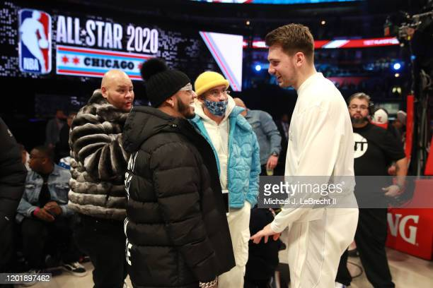 Rappers Anuel AA Fat Joe and Bad Bunny talk with Luka Doncic of Team LeBron during the NBA AllStar Game as part of 2020 NBA AllStar Weekend on...