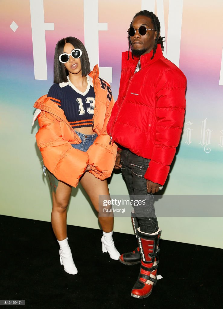 Rappers Cardi B (L) and Offset of Migos attend the Fenty Puma by Rihanna show during New York Fashion Week at the 69th Regiment Armory on September 10, 2017 in New York City.