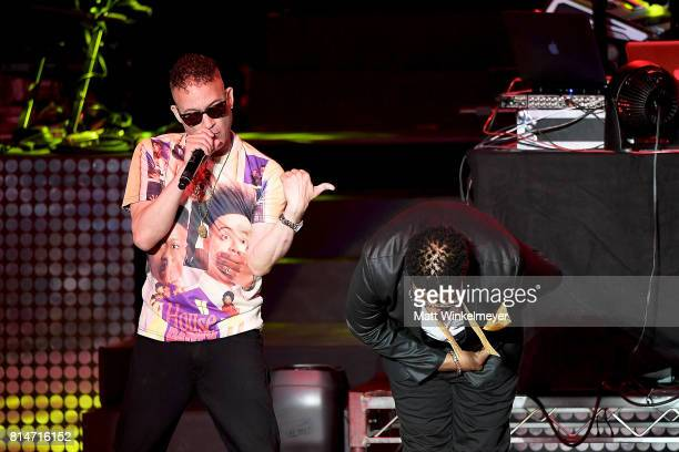 Rappers Christopher 'Kid' Reid and Christopher 'Play' Martin of Hip hop duo Kid 'n Play perform onstage during the I Love The 90s The Party Continues...