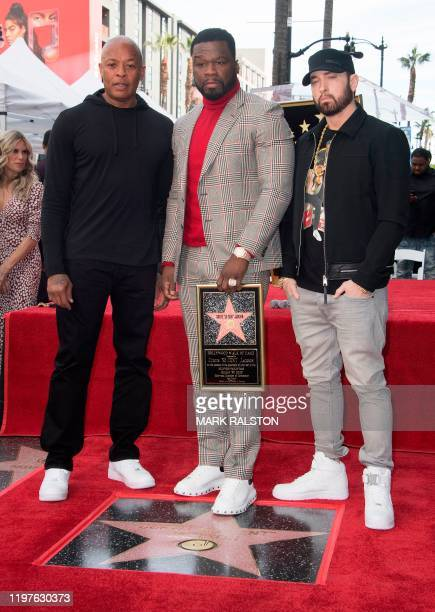 """Rappers Dr. Dre, Curtis Jackson and Eminem pose for pictures during the ceremony honoring Curtis """"50 Cent"""" Jackson with a Star on The Hollywood Walk..."""