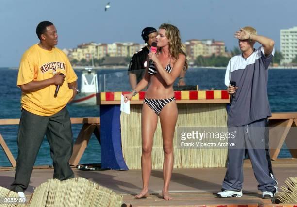 Rappers Dr Dre Eminem and MTV VJ Rebecca RomijnStamos perform during MTV's Spring Break 2000 in Cancun Mexico