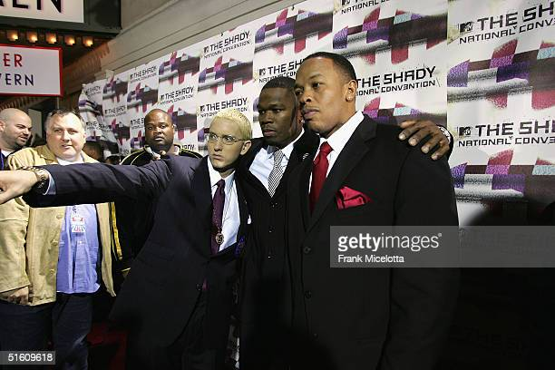 Rappers Eminem 50 Cent and Dr Dre arrive at the Shady National Convention to launch Shade 45 a new satellite radio station at the Roseland Ballroom...