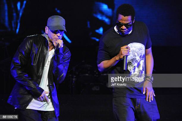 Rappers Eminem and JayZ perform at the launch of 'DJ Hero' hosted by ActiVision held at The Wiltern on June 1 2009 in Los Angeles California