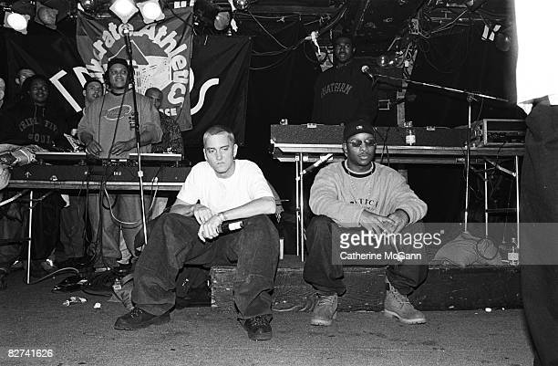 Rappers Eminem left and Royce Da 5'9 right with unidentified rappers and DJs on turntables in background perform at Tramps in March 1999 in New York...