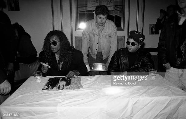 Rappers Fab Morvan and Rob Pilatus from Milli Vanilli signs autographs for fans prior to their concert at the Riviera Theatre in Chicago Illinois in...