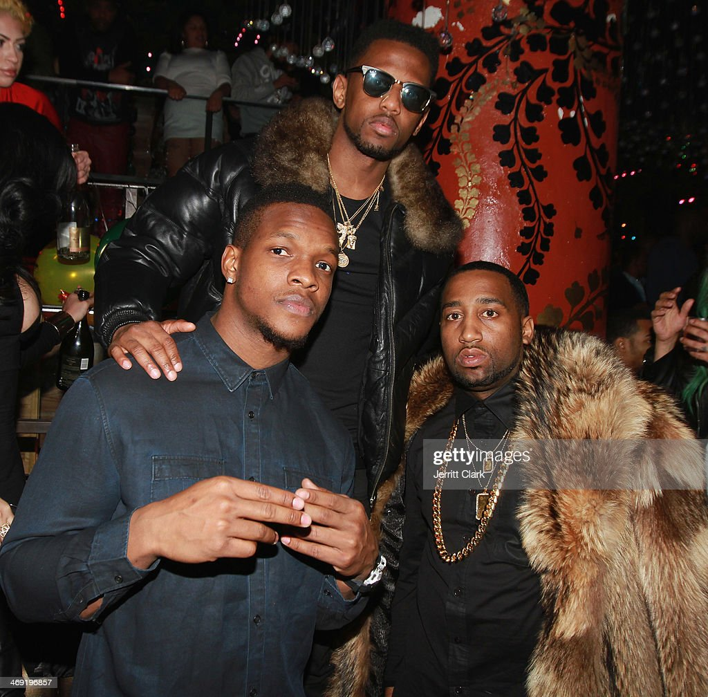 Rappers Fabolous and Slow Bucks pose with Seattle Seahawks Philip Bates (C) at Emily B.'s Birthday Party at Greenhouse on February 11, 2014 in New York City.