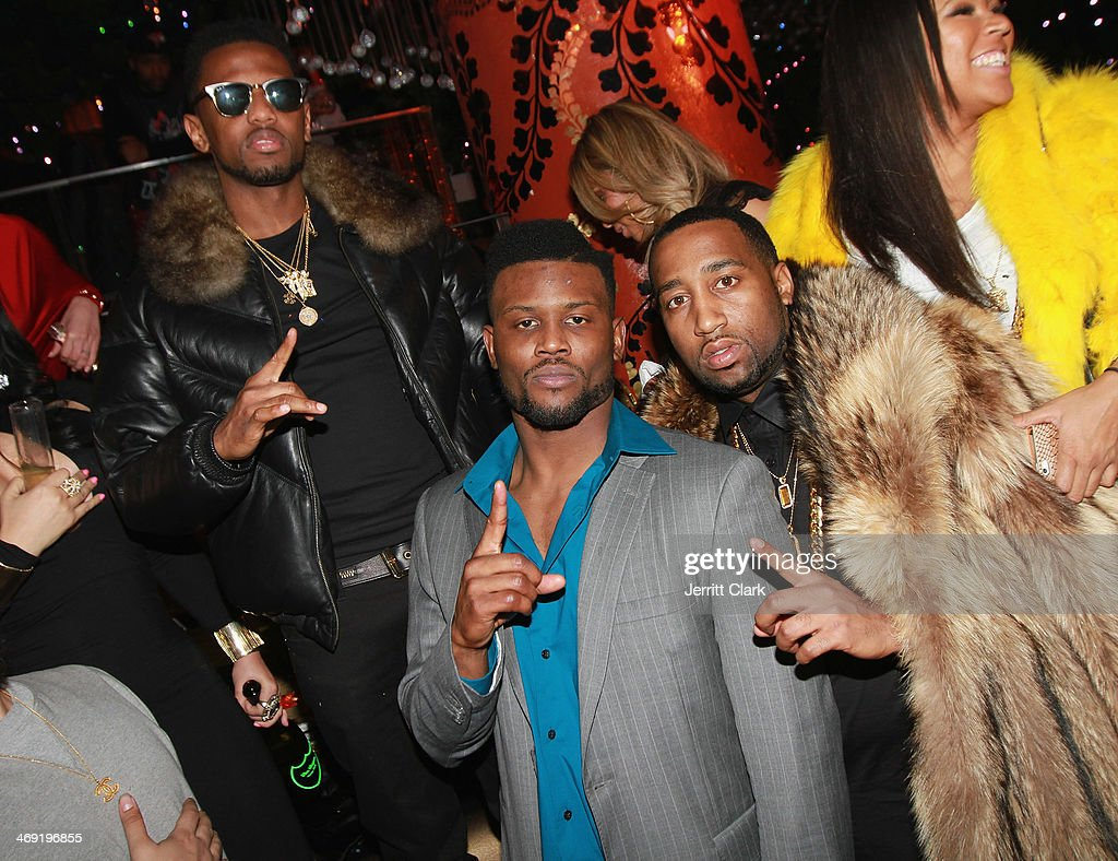 Rappers Fabolous and Slow Bucks pose with Seattle Seahawks Walter Thurmond at Emily B.'s Birthday Party at Greenhouse on February 11, 2014 in New York City.
