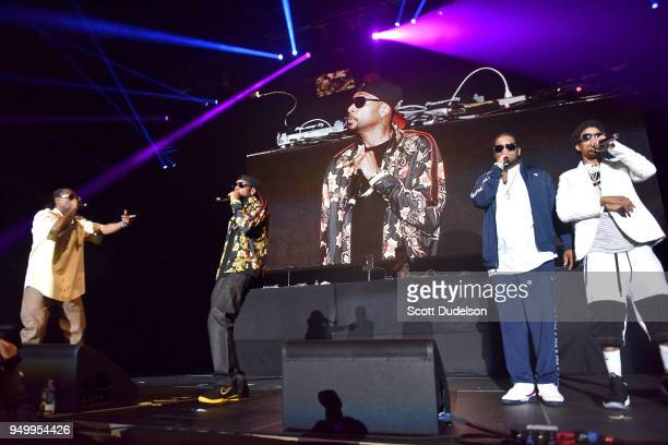 Rappers FleshnBone Krayzie Bone Wish Bone and Layzie Bone of Bone ThugsnHarmony perform onstage during the KDay 935 Krush Groove concert at The Forum...