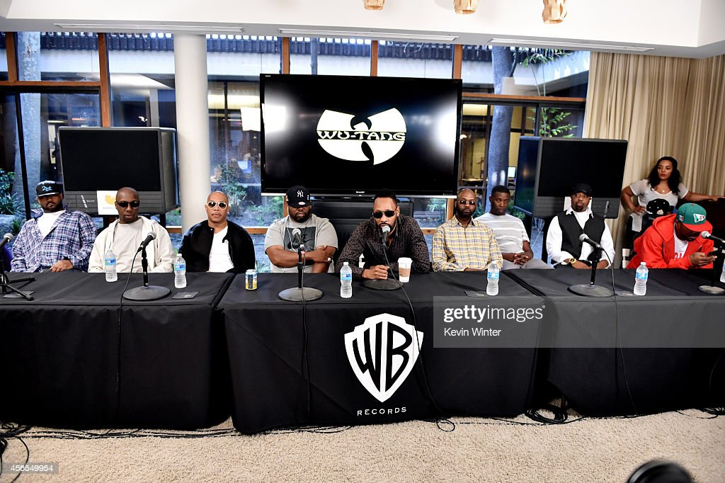 L-R) Rappers Ghostface Killah, Inspectah Deck, U-God, Raekwon, RZA, Masta Killa, GZA, Cappadonna and Method Man of the Wu-Tang Clan pose at a press conference to announce they have signed with Warner Bros. Records at Warner Bros. Records on October 2, 2014 in Burbank, California.