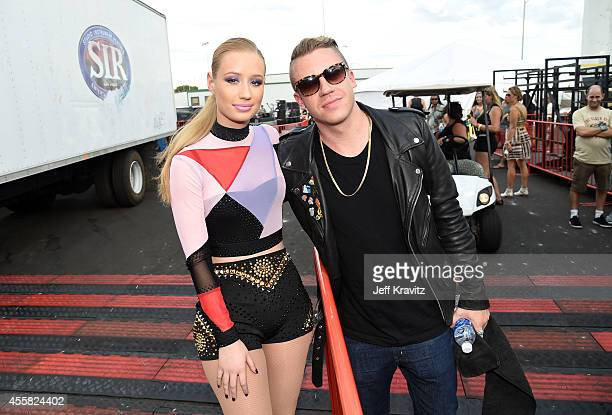 Rappers Iggy Azalea and Macklemore attend the 2014 iHeartRadio Music Festival Village on September 20 2014 in Las Vegas Nevada