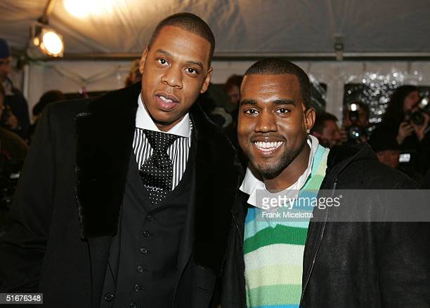 Rappers JayZ and Kanye West arrive for the world premiere of concert film JayZ 'Fade to Black' November 4 2004 at the Zigfield theater in New York...