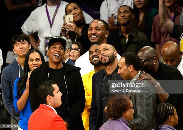 Rappers JayZ and Kanye West attend Kobe Bryant's final game between the Utah Jazz and the Los Angeles Lakers at Staples Center on April 13 2016 in...