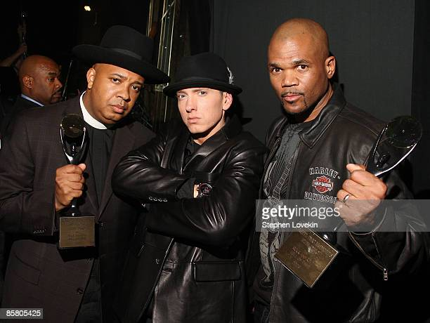 Rappers Joseph 'Rev Run' Simmons Eminem and Darryl 'DMC' McDaniels attend the 24th Annual Rock and Roll Hall of Fame Induction Ceremony at Public...