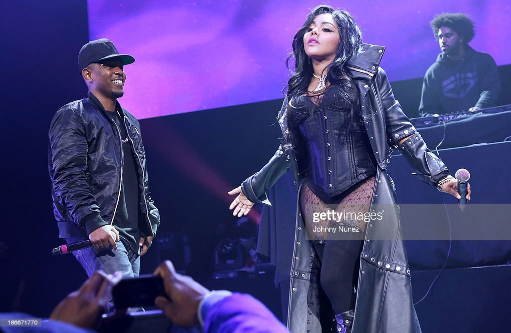 Rappers Kendrick Lamar and Lil' Kim perform onstage at Power 105.1's Powerhouse 2013, presented by Play GIG-IT, at Barclays Center on November 2, 2013 in New York City.