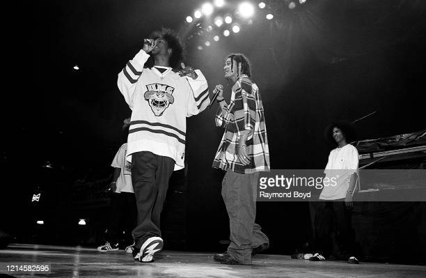 Rappers Krayzie Bone Bizzy Bone and Layzie Bone of Bone ThugsNHarmony performs at the International Amphitheatre in Chicago Illinois in April 1995