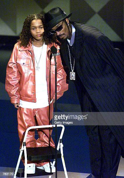 Rappers Lil Bow Wow left and Snoop Dogg present an award during the 28th Annual American Music Awards January 8 2001 in Los Angeles CA
