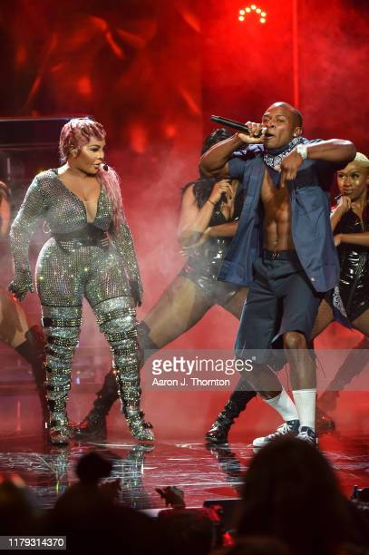 Rappers Lil Kim and OT Genasis perform onstage at the 2019 BET Hip Hop Awards at Cobb Energy Performing Arts Centre on October 05 2019 in Atlanta...