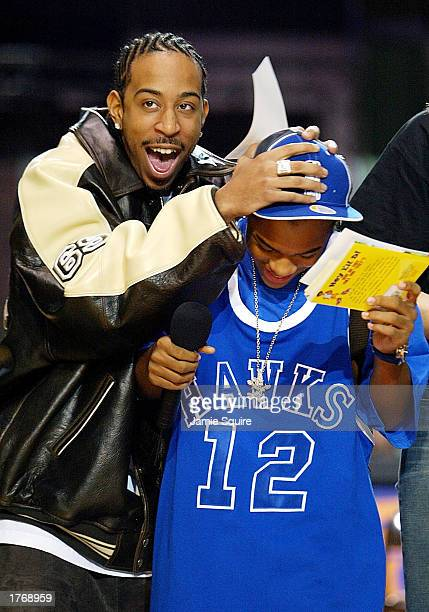 Rappers Ludicris and Lil' Bow Wow joke around during the NBA Read To Achieve Reading Rally at the NBA AllStar Jam Session on February 7 2003 at the...