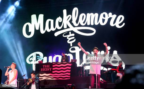 Rappers Macklemore & Ryan Lewis perform with musician Christopher Mansfield of the band Fences at the Twin Peaks Stage during day 2 of the 2014...