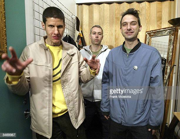"""Rappers Michael Diamond """"Mike D"""", Adam Yauch """"MCA"""", and Adam Horovitz """"Ad-Rock"""" of the Beastie Boys pose in the dressing room before taping MTV's..."""