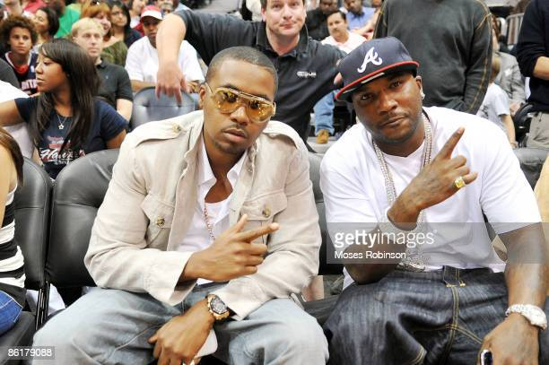 Rappers Nas and Young Jeezy attend the Miami Heat and Atlanta Hawks playoff game 2 at Philips Arena on April 22 2009 in Atlanta Georgia