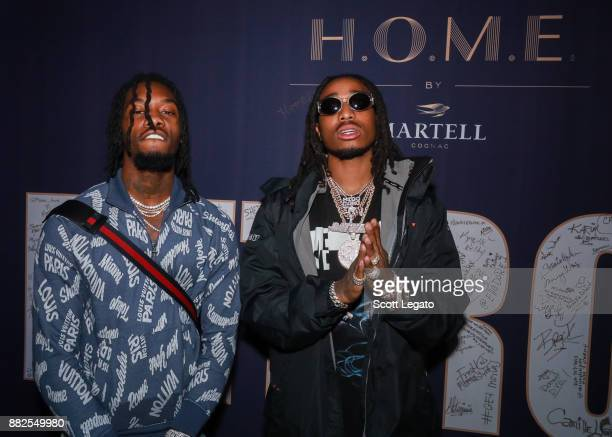 Rappers Offest and Quavo pose at the HOME by Martell event on November 29 2017 in Detroit Michigan
