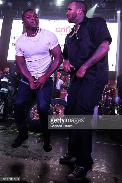 Rappers OT Genasis and The Game on stage at The Documentary 10th anniversary party and concert on January 18 2015 in Los Angeles California