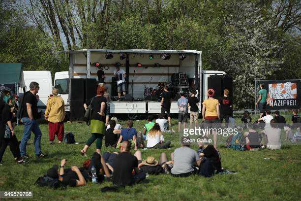 Rappers peform at a leftist counter music fest coinciding with a nearby neoNazi music fest on April 21 2018 in Ostritz Germany By early afternoon...