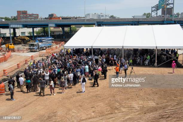 Rappers, politicians, developers, and the media attend the ground breaking ceremony for the future Universal Hip Hop Museum on May 20, 2021 in the...